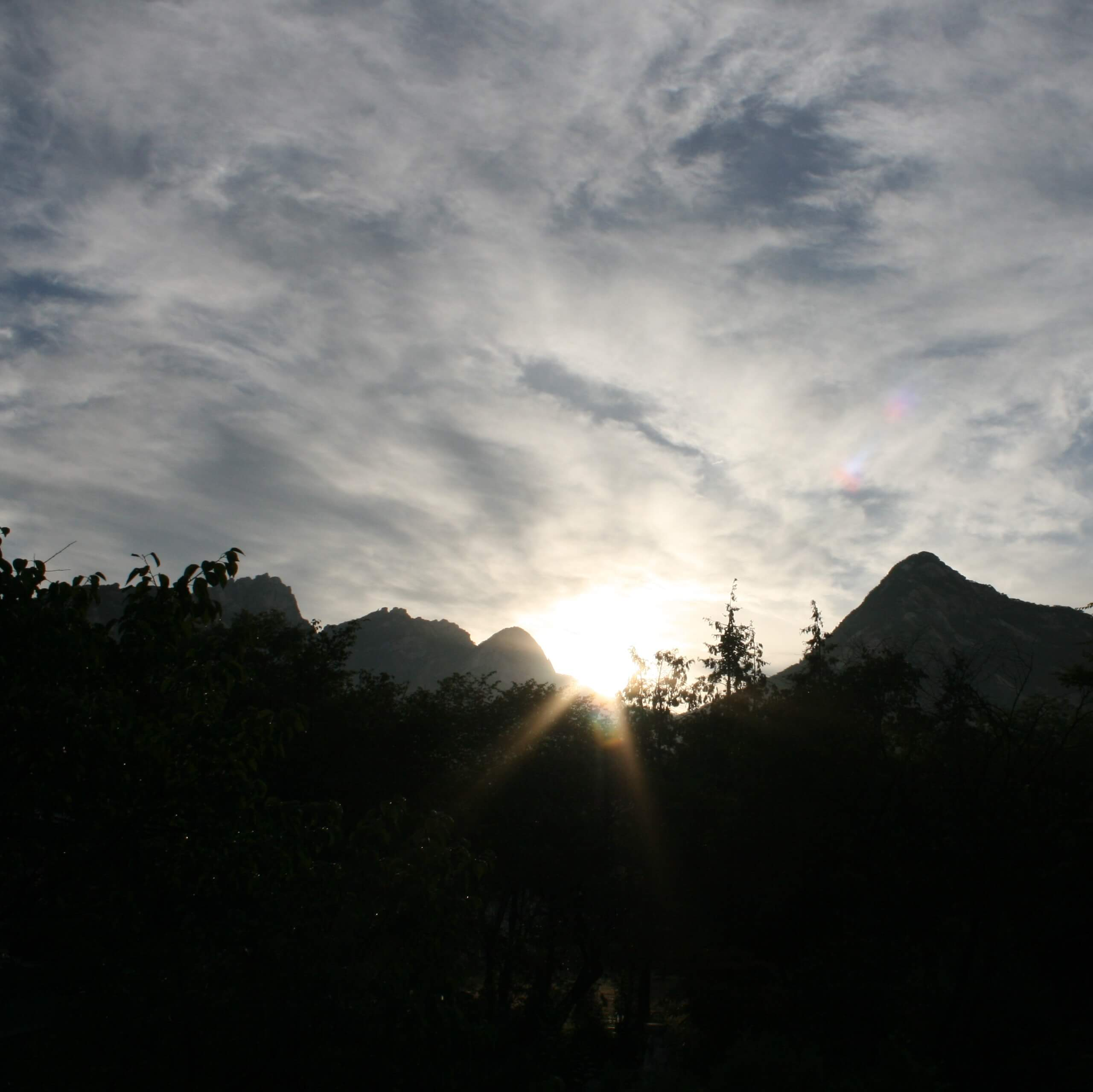 mountains with sun setting behind