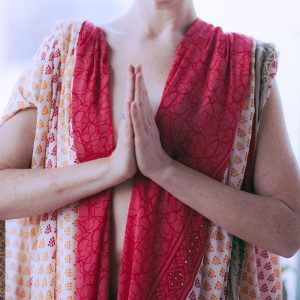 woman's torso in Namaste pose
